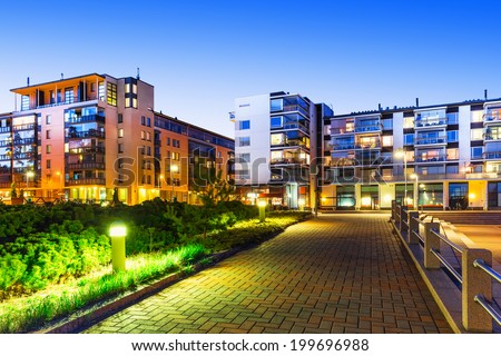 House building and city construction concept: evening outdoor urban view of modern real estate homes #199696988