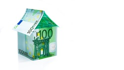 House built of banknotes isolated