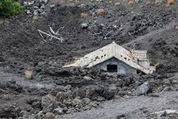 House buried under lava on southern flank of Mount Etna volcano, Sicily, Italy