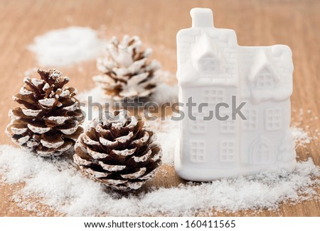 House christmas decoration and snowed trees