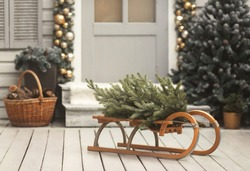 House christmas decorations. Sled with tree