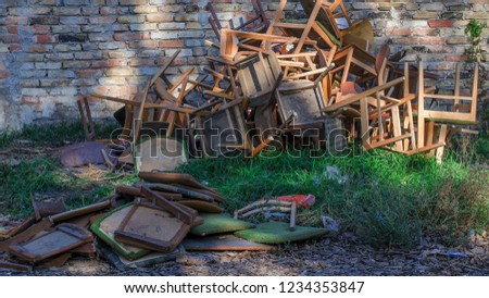 house clearance in front of a bricked wall with a lot of chairs