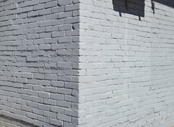 House corner, Brick wall painted with white paint.