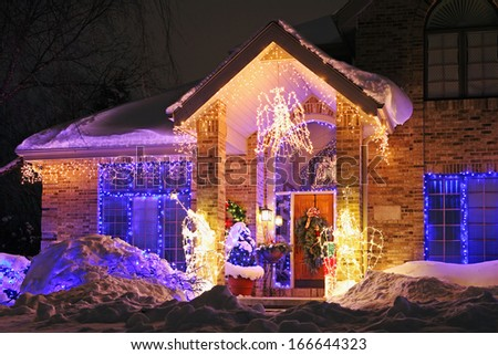 House decorated with Christmas lights #166644323