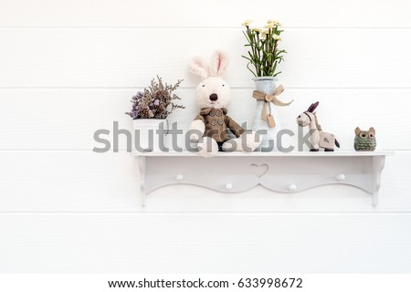House decoration, Wall decoration, decorated with shelf attached on a wall, probably in the kid's room