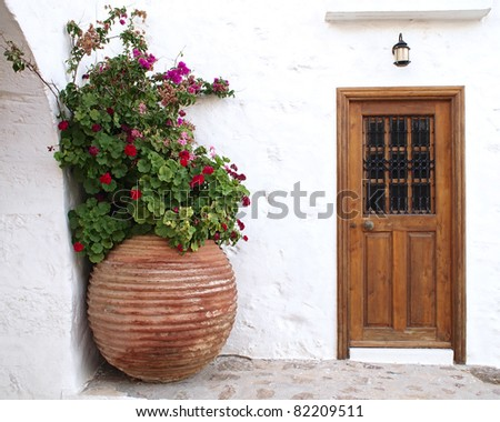 house door and huge flower jar, Greece