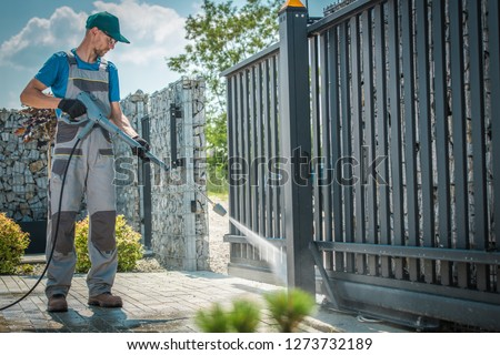 House Driveway and the Gate Pressure Washing by Caucasian Men #1273732189