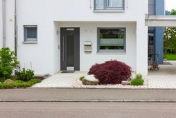 house entrance of new modern building in germany springtime
