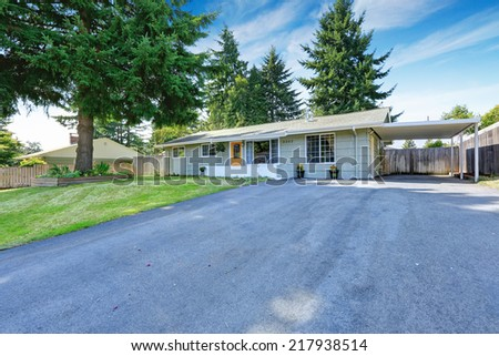 House exterior. Entrance porch with yellow door and french windows. Asphalt driveway #217938514