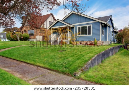 House exterior. View of front yard and small entrance porch