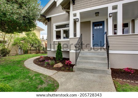 House exterior with entrance porch. View of staircase and front yard landscape
