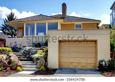 House exterior with large garage and staircase.