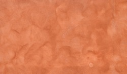 house facade in warm terracotta colors, marbled with sponge effect. Autumnal background
