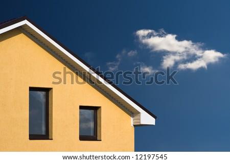 House facade on the blue sky