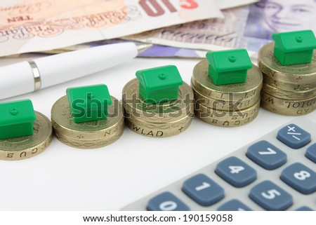 House Finance Green houses on rising stacks of coins, to represent eco finance and savings.