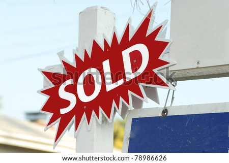 house for sale and sold sign