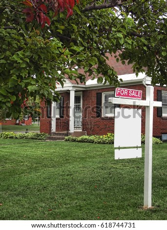 house for sale with for sale sign on lawn