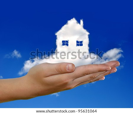 house from clouds in the hand on blue sky