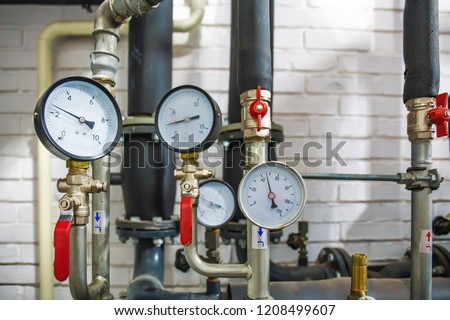 House heating system with many steel pipes, manometers and metal tubes, selective focus #1208499607