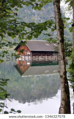 House in a beautiful lake in Austria. peaceful park and peaceful life #1346327078