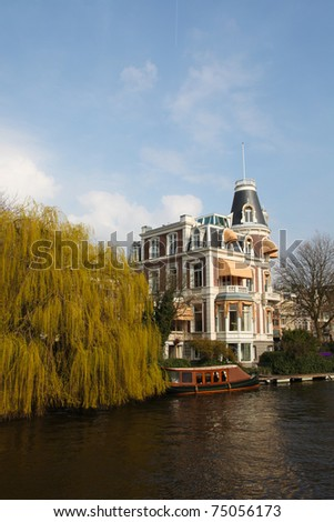 """House in Amsterdam at one of the many canals (""""Grachten"""" in Dutch) of the city."""