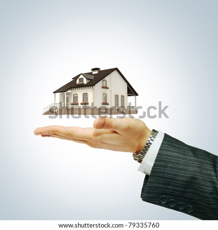 House in businessman's hand