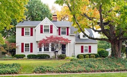 House in Fall with Red Shutters