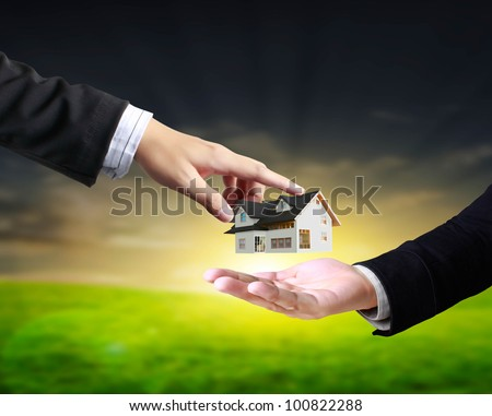 house in human hands, businessmen