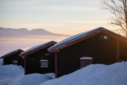 House in the snow at sunrise