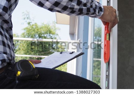 House inspectors or home building contractors use water levels and the clipboard is checking.
