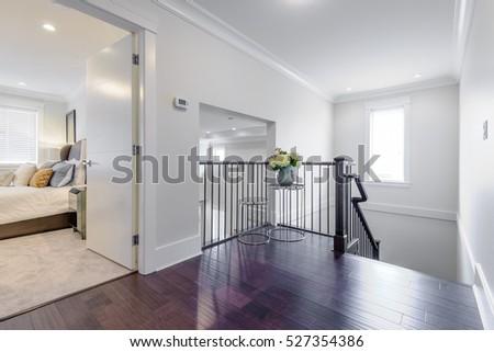 House interior. Entrance hallway with white door and hardwood floor.