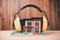 house is covered with headphones to reduce noise , Solving the problem of noise pollution around the residence