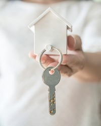 House key in landlord, real estate sale person or home Insurance broker agent hand giving to tenant, renter, buyer customer for new family owner, property assurance concept