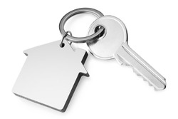 House key with a house shaped keychain, isolated on white background