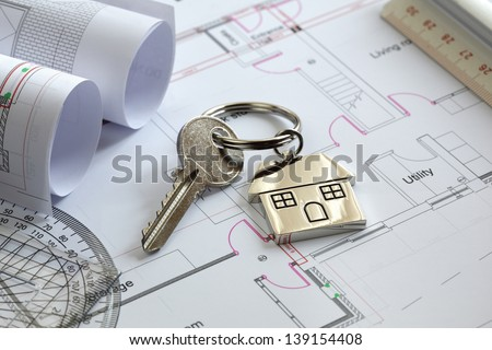 House Keys On A House Plan Blueprint Concept For New House Design Or Home Improvement