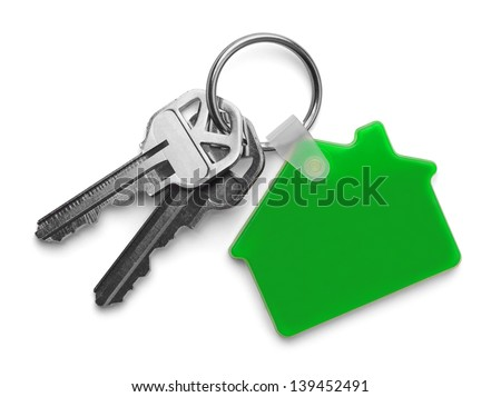House keys with Green House Key chain Isolated on White Background.