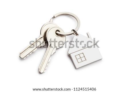 Photo of  House keys with house shaped keychain, isolated on white background