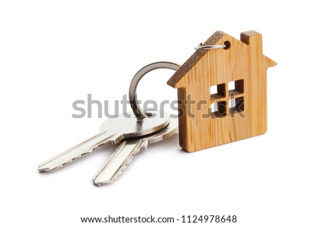 House keys with house shaped keychain, isolated on white background #1124978648