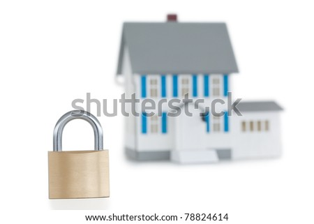 House locked with padlock against a white background