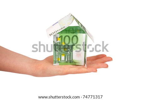 House made from euro bills in female's hand