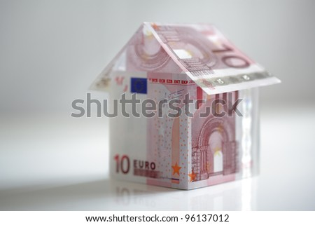 House made from ten euro banknotes concept for property prices, mortgage or home finances