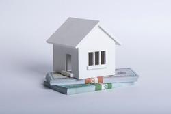 House Made of Cash Money Isolated on White Background.