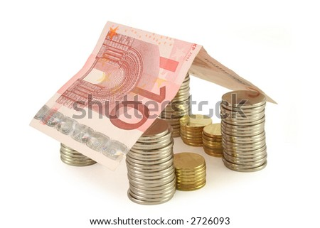 House made of coins and euro banknote - real estate concept (isolated, clipping path)