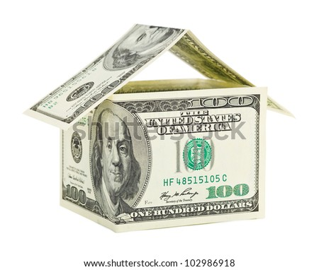 House made of money isolated on white background