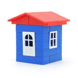 House made of plastic bricks. Isolated on white background