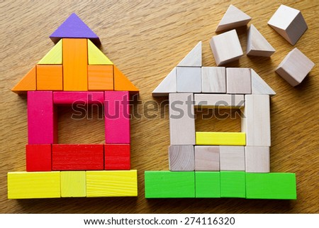 house made of wooden cubes on the table