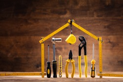 House Made Up Of Measuring Tape Over Tools With Various Worktools