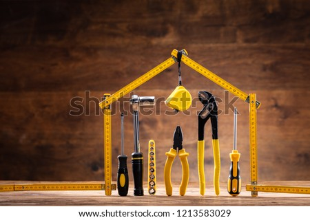 House Made Up Of Measuring Tape Over Tools With Various Worktools Foto stock ©