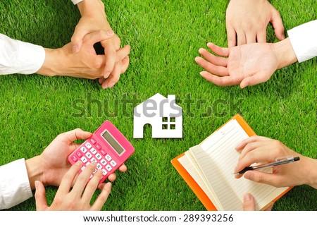 House miniature and hand,Green turf