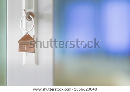House model and key in house door. Real estate agent offer house, property insurance and security, affordable housing concepts